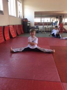 """<img src="""" boy in splits.jpg"""" alt=""""kickboxing classes near me""""/>"""